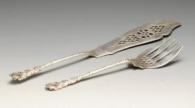 A pair of late Victorian silver fish servers, the