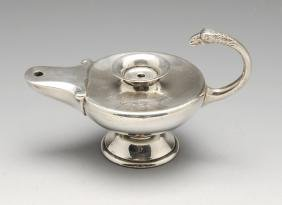 A 1920's silver table lighter modelled as a lamp with