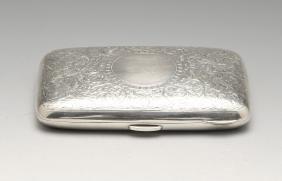 A large Edwardian silver cigarette case, the slightly