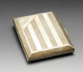 A 1920's silver cigarette case, the rectangular form