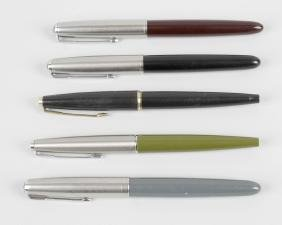 Five assorted Parker fountain pens, to include two