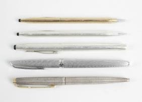 A group of assorted pens and pencils, to include a