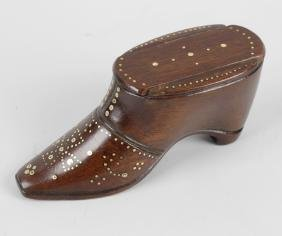 A treen novelty snuffbox, modelled as a shoe, with