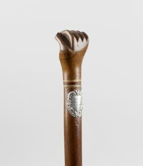 A late 19th century caved wooden walking cane, the