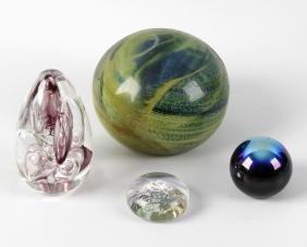 A box containing assorted glass paperweights and other
