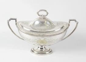 A box containing a silver plated tureen and cover, of