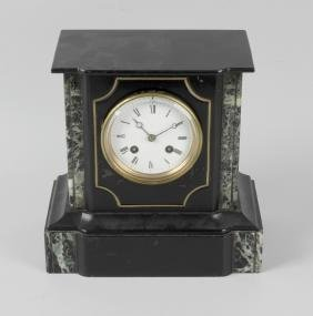 A late 19th century French black slate mantel clock.