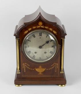 An Edwardian mahogany cased mantel clock, the inlaid