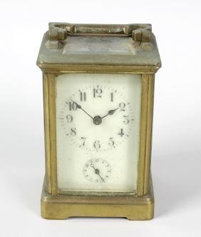 A brass carriage clock. Early 20th century, the cream