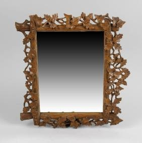 A 19th century carved wooden framed wall mirror, the