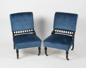 A pair of late Victorian ebonised parlour chairs. Each