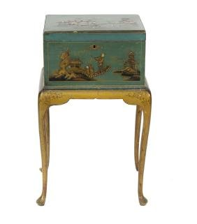 An early 20th century wooden sewing box on stand, the