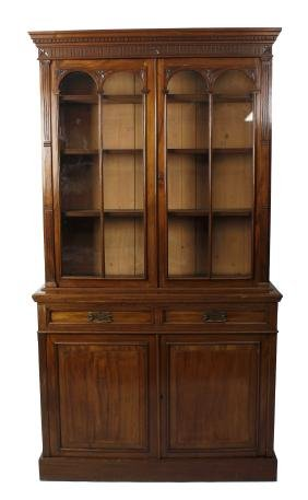 A late Victorian carved mahogany bookcase cabinet. The