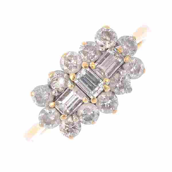 An 18ct gold diamond cluster ring. Designed as a three