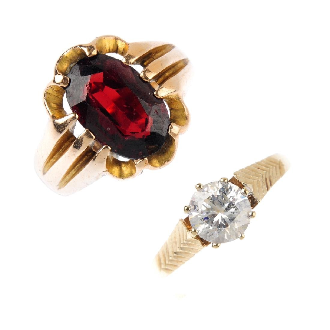 Four 9ct gold gem-set rings. To include a diamond dress