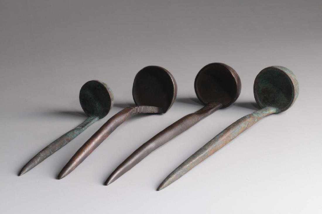 A GROUP SPOONS FOR GRAIN