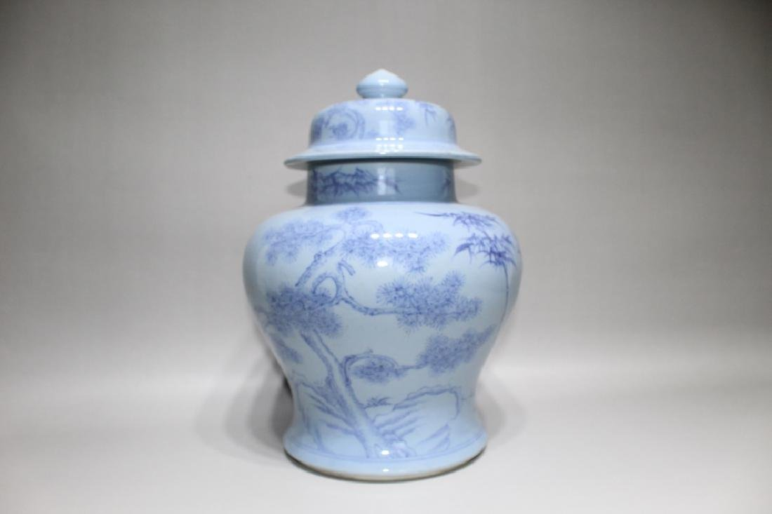 BLUE AND WHITE HAT COVERED JAR