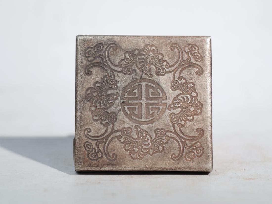 An antique copper compact