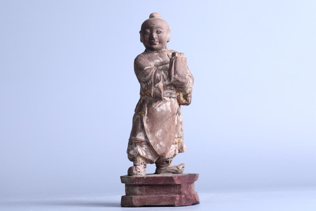 colored drawing figurine with stand