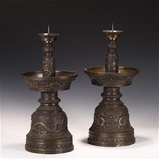 A PAIR OF CHINESE BRONZE CANDLE HOLDERS