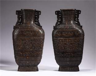 A PAIR OF CHINESE CARVED HARDWOOD VASES