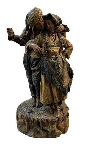 Polychrome Sculpture Of A Couple Embracing