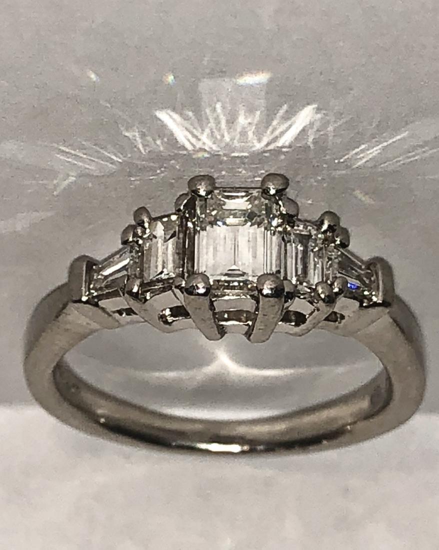 Exceptional Platinum 1.0 TCW VVS1, F color  emerald cut