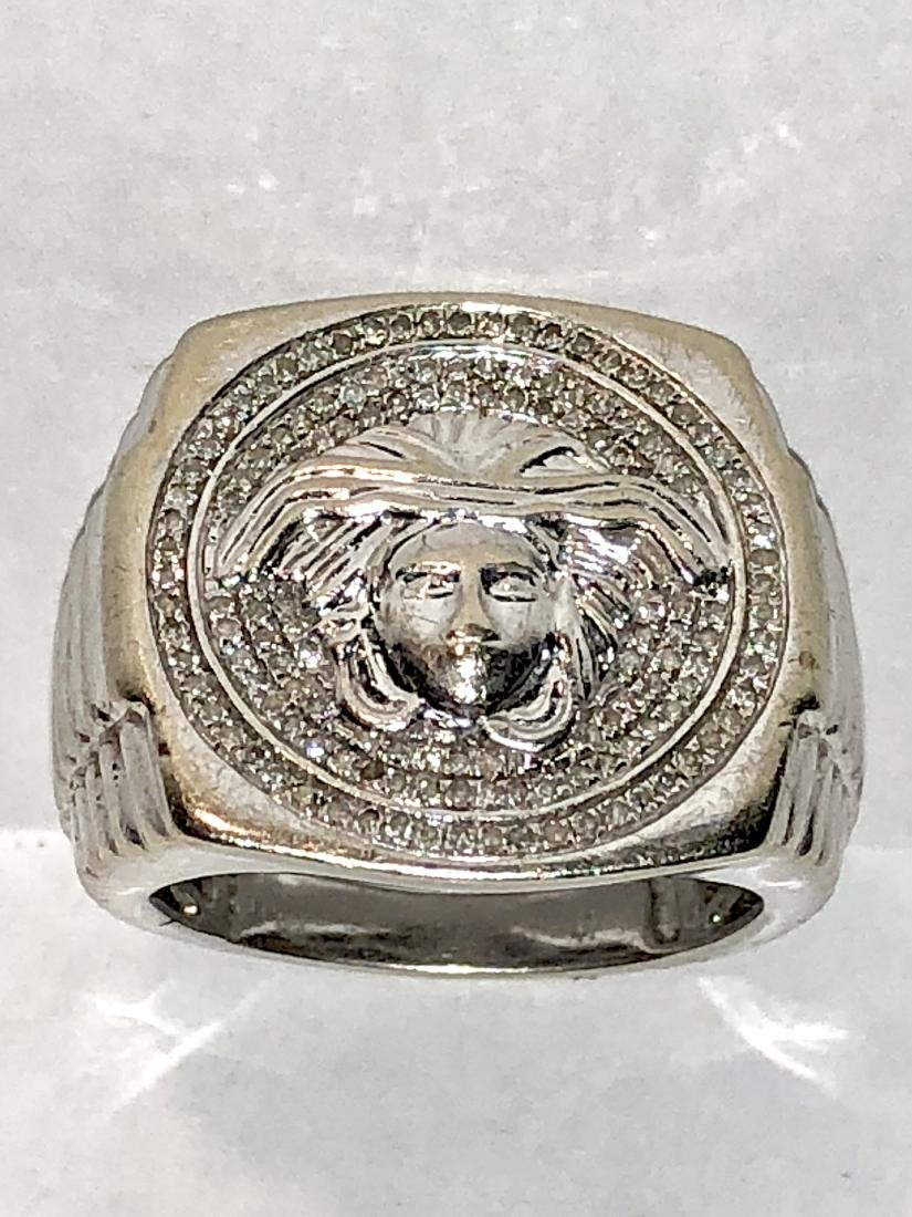 10k gold 1.0 TCW SI1, G diamonds Medusa ring.