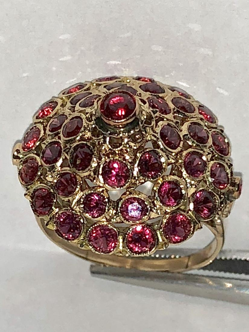 14K gold 3.0 TCW ruby harem ring.
