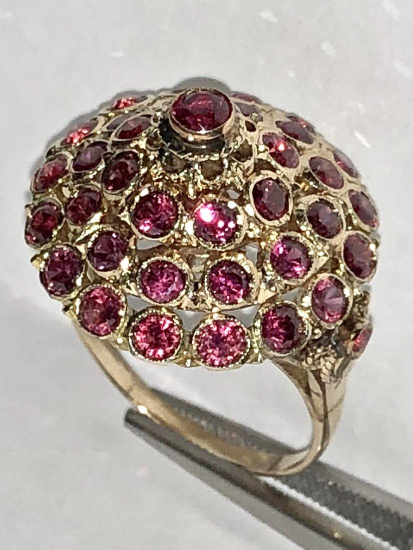 14K gold 3.0 TCW ruby harem ring. - 2