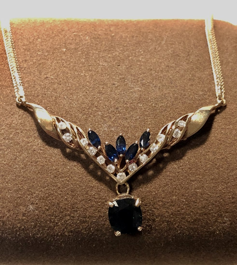 14K gold 2.79 TCW sapphires and diamonds necklace.