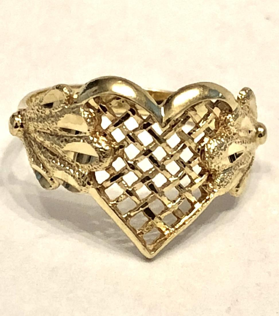 14K GOLD HEART SHAPED DESIGNER RING.