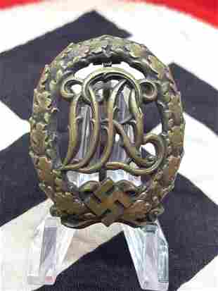 GERMAN WW2 3RD REICH DRL BADGE IN BRASS W/MAKER MARKS