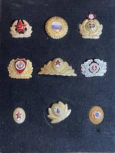 FRAMED LOT OF (9) RUSSIAN SOVIET HAT BADGES