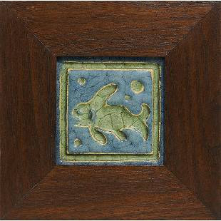 Grueby earthenware fish tile in blue and green