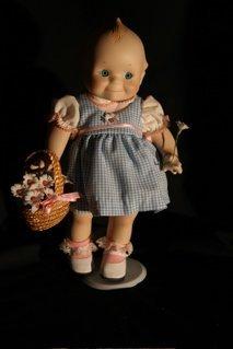 """21: """"Basket of Love"""" Kewpie doll"""
