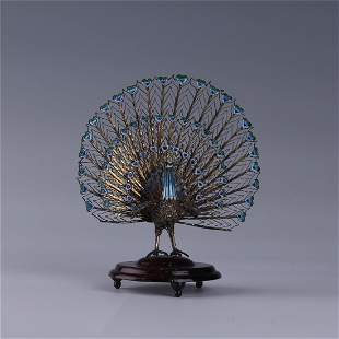 A CHINESE SILVER FILIGREE ENAMEL PEACOCK