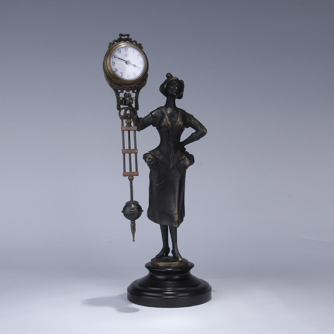 CAST METAL FIGURAL GERMAN SWING ARM CLOCK