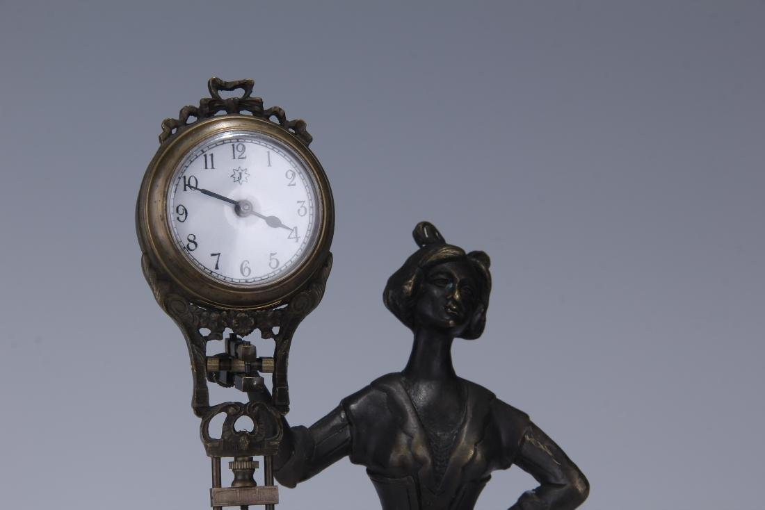 CAST METAL FIGURAL GERMAN SWING ARM CLOCK - 2