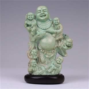 A GREEN STONE BUDDHA SCULPTURE & KIDS