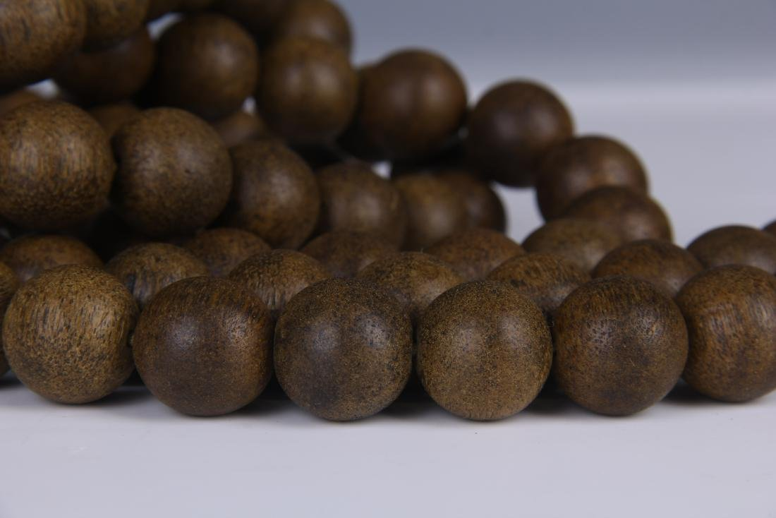 A STRING OF CHENGXIANG WOOD BUDDHA BEADS - 8