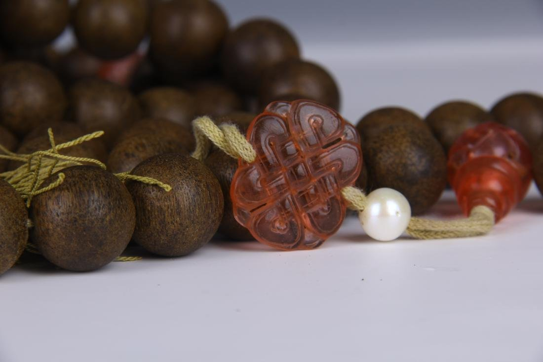 A STRING OF CHENGXIANG WOOD BUDDHA BEADS - 9