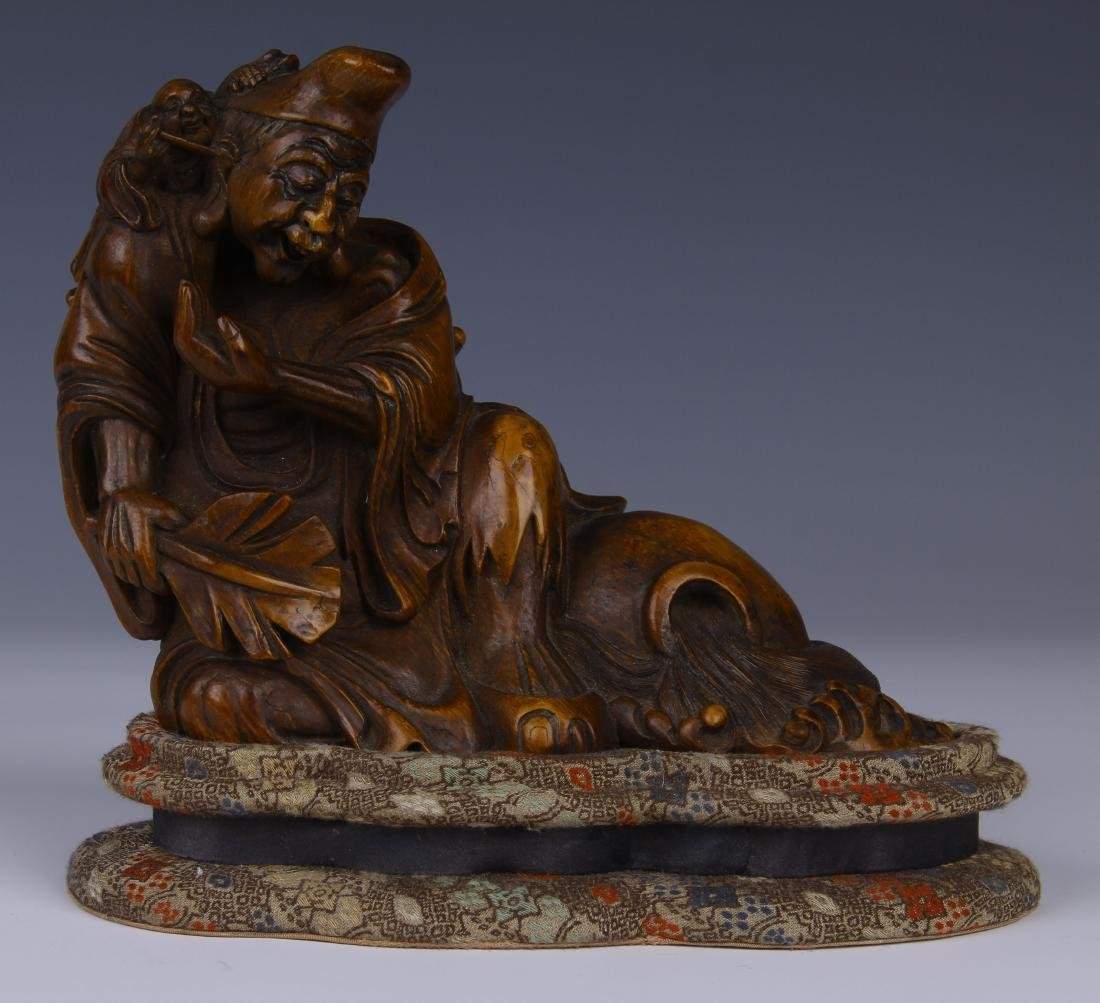 CHINESE CARVED BAMBOO RECUMBENT ARHAT ON STAND