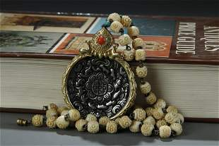 GILT BRONZE PENDANT WITH BONE CARVED BEADS