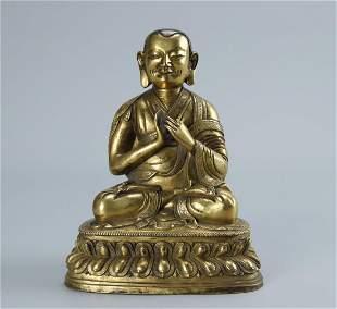 A GILT BRONZE FIGURE OF GURU BUDDHA