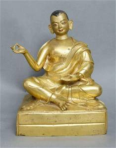 EARLY MING GILT BRONZE STATUE OF GURU BUDDHA