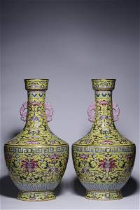 PAIR OF YELLOW GROUND FAMILLE ROSE PORCELAIN VASES