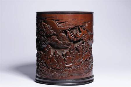 A BAMBOO CARVING 'IMMORTAL FIGURES' BRUSH POT