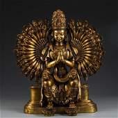A GILT BRONZE FIGURE OF MANY-ARMED GUANYIN BUDDHA