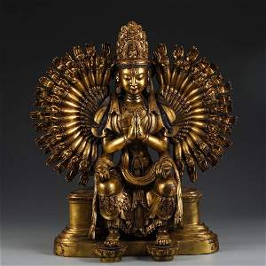 A GILT BRONZE FIGURE OF MANY-ARMED GUANYIN BUDDHA